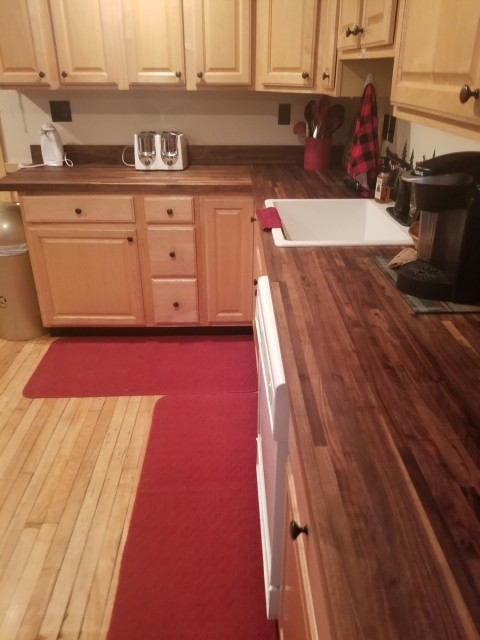 kitchen with new butcherblock counters, country sink
