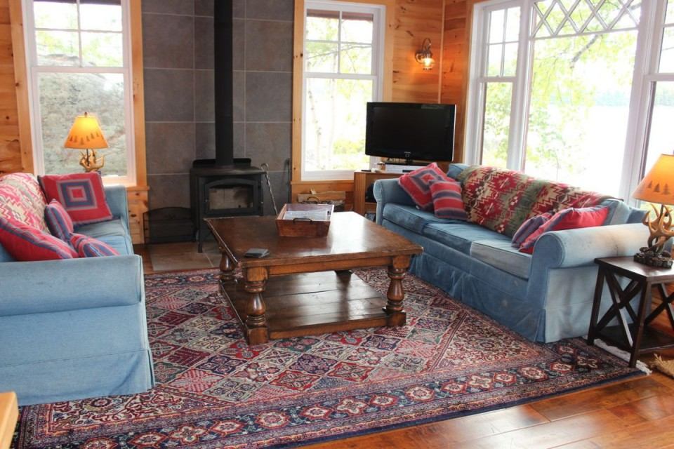 Main cabin living room with wood burning stove
