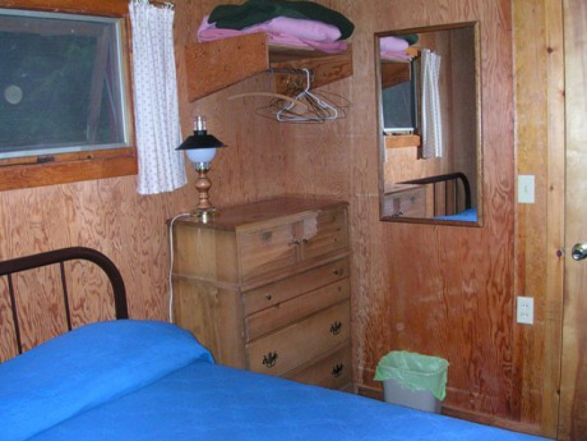 Small bedroom has a double bed.