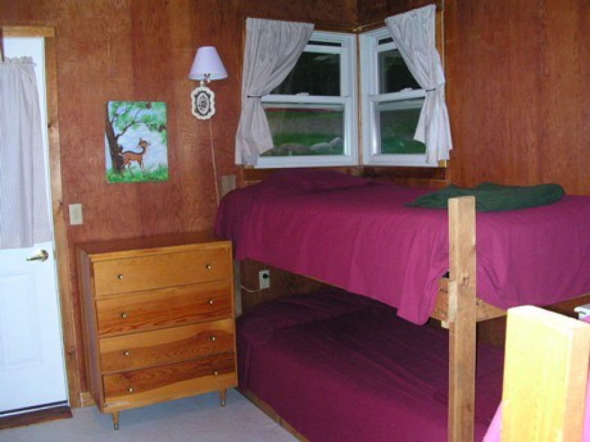 Large bedroom has two twin-size bunkbeds.
