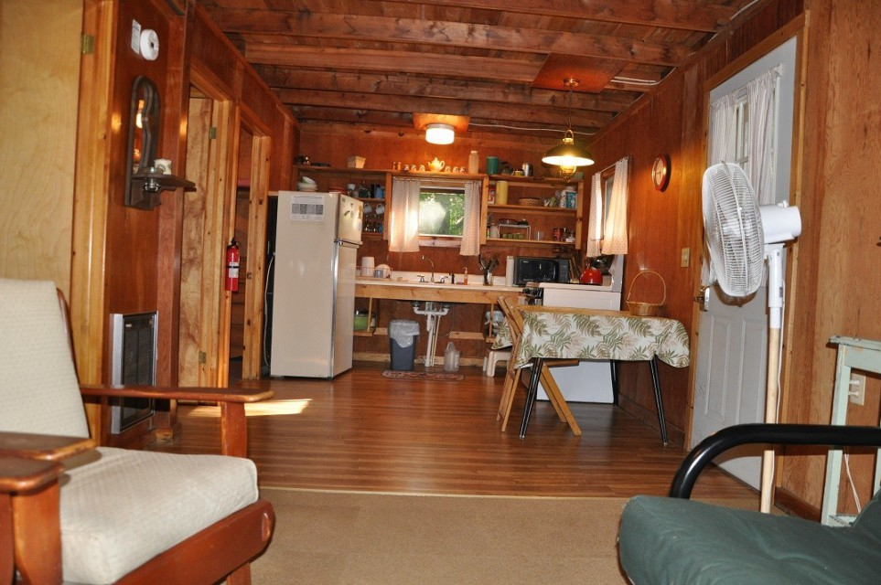 Kitchen area has full size stove and refrigerator