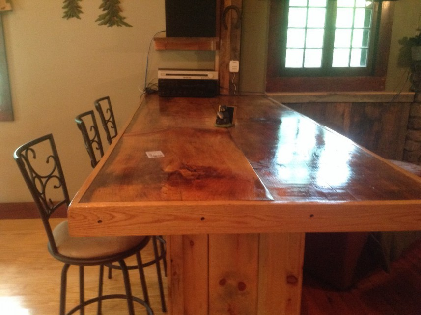 The bar is made of large Adirondack wood slabs