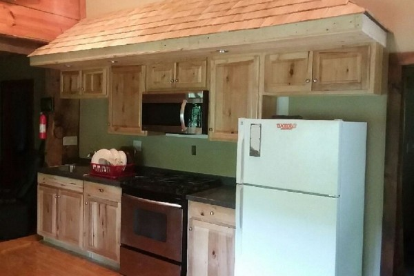 A new Kitchen with hickory cabinets.
