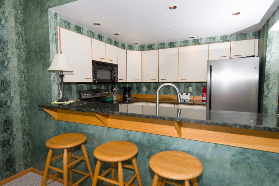 Another view of our open kitchen, granite counters!