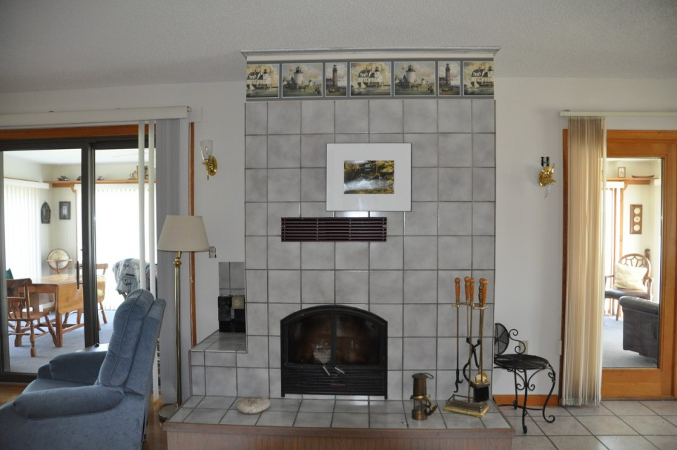Fire place and 2 access points to front porch.