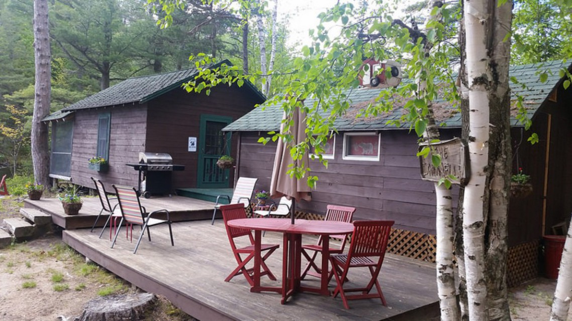 Camping cabins are connected with a spacious deck.