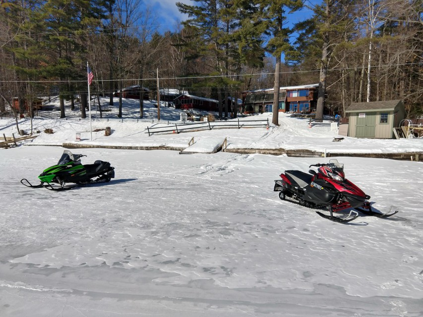 Snowmobiling right from our beach!