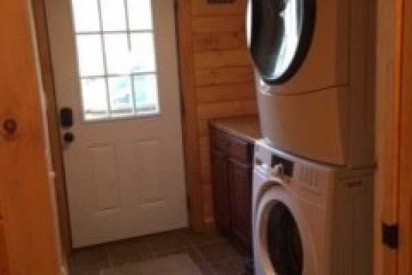 Side entrance with large washer and dryer