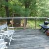 Rear deck, outdoor shower, off kitchen