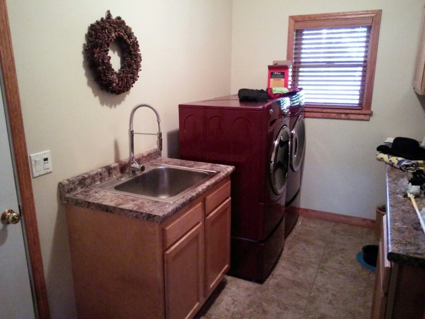 Laundry room off kitchen and leading to garage