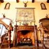 The Great Hall fireplace flanked by life-size knights.