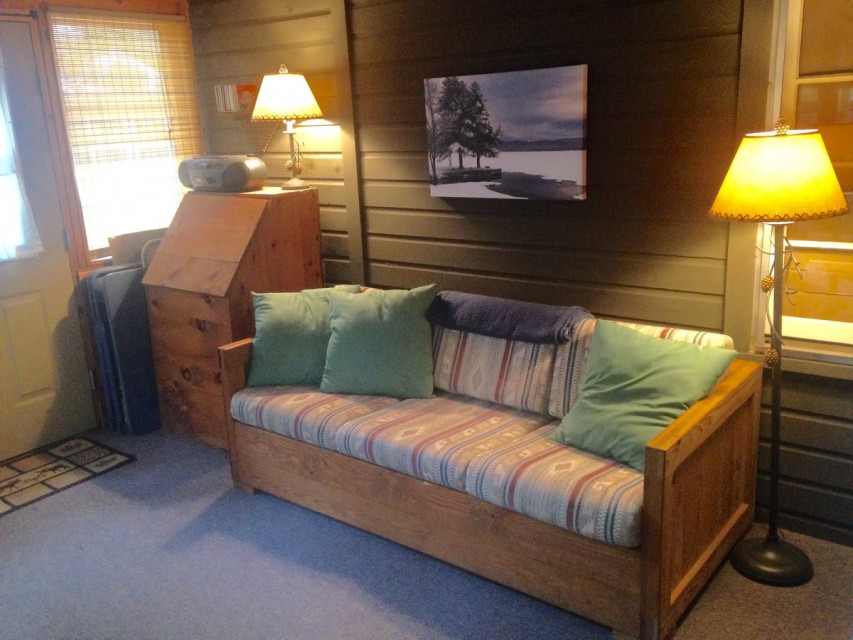 Back porch:  Queen pullout sofa, Tv w DVD, CD player