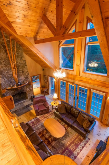 Great room with wood burning fire place and TV