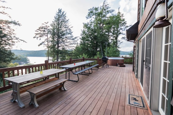 Deck with hot tub, charcoal grill, seating for 24
