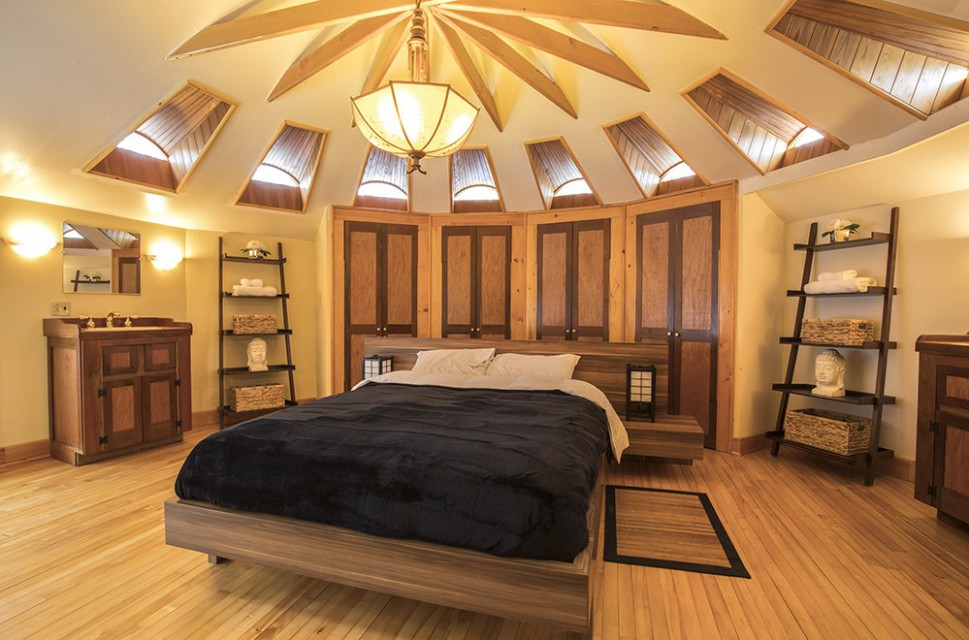 MASTER BEDROOM WITH PEACEFUL WOODED VIEWS