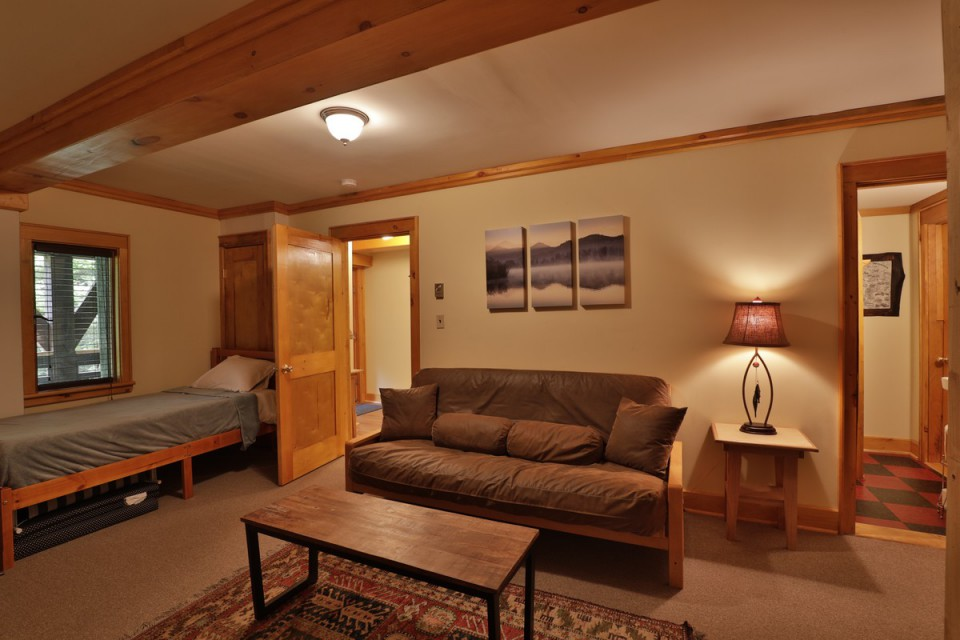 BEDROOM INCLUDES TWIN BED, FUTON, AND A COT