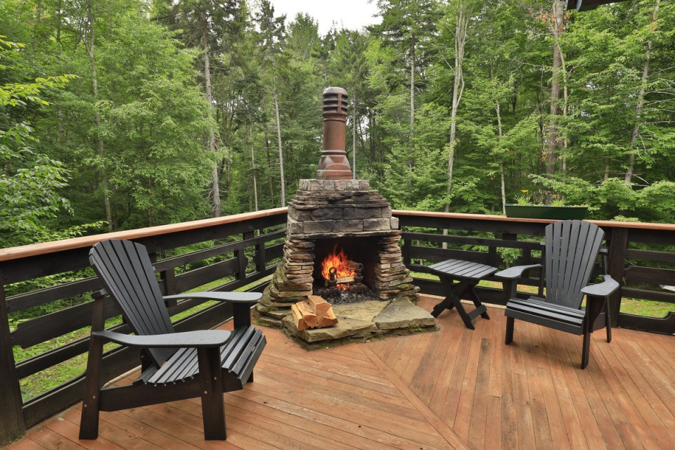 BEAUTIFUL OUTDOOR FIREPLACE WITH WOODED VIEWS