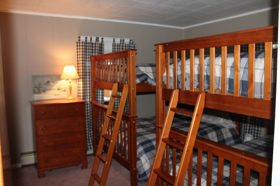 Bunk room with 4 full beds