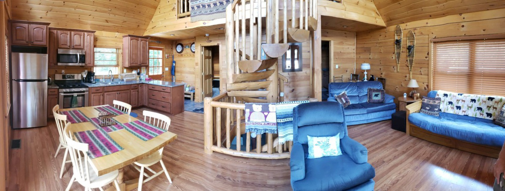 Kitchen, living room, spiral log staircase