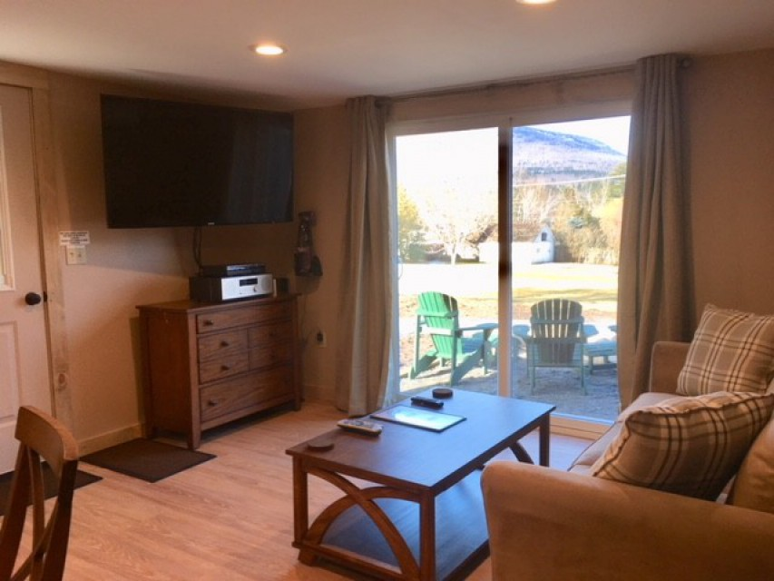 Living Room with view of Patio and Whiteface Mountain.