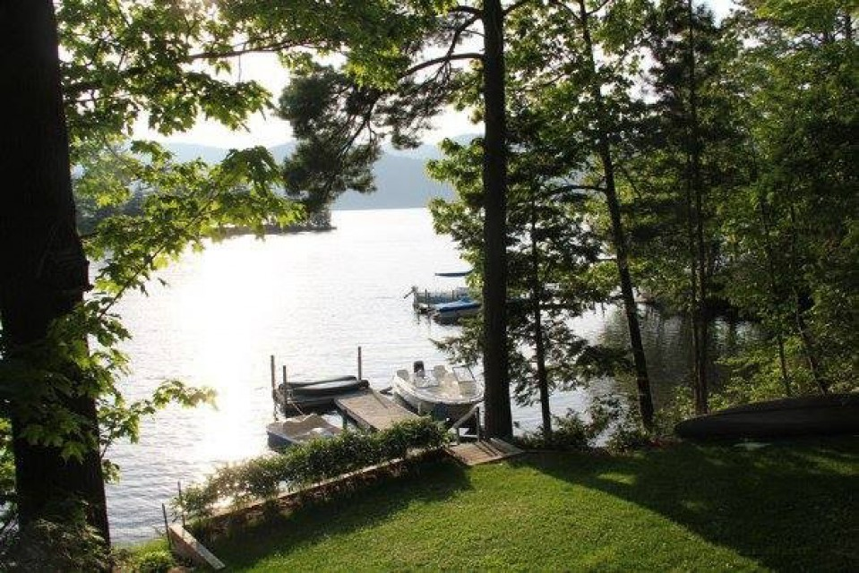 View of private dock and lawn from front porch