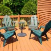 Large deck with grill, furniture and large umbrella.