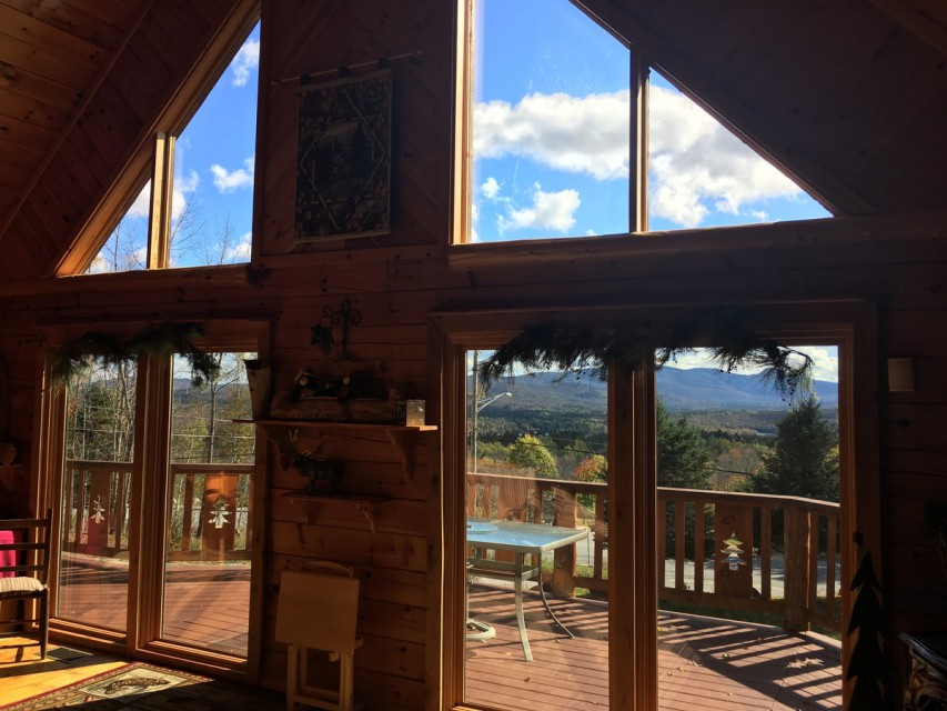 Looking out from the living room, deck and mountains